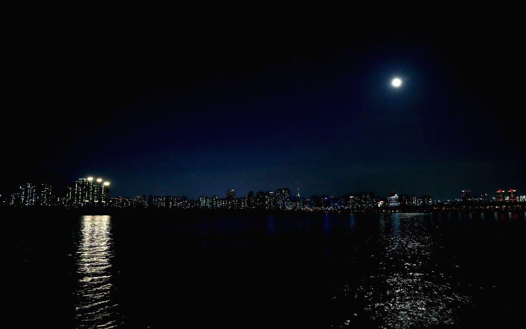SEOUL, Feb. 19, 2019 - Photo taken on Feb. 19, 2019 shows the full moon over the Han-gang River in Seoul, capital of South Korea.