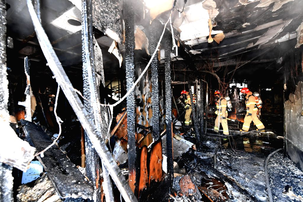 SEOUL, Jan. 26, 2018 - Firefighters work in a damaged room of a hospital after a fire in Miryang, South Korea, Jan. 26, 2018. A fire at a hospital in southeast South Korea killed at least 37 people ...