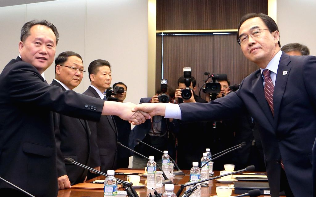 SEOUL, June 1, 2018 - South Korean Unification Minister Cho Myoung-gyon (R) shakes hands with Ri Son Gwon, chairman of the Committee for the Peaceful Reunification of the Fatherland of the Democratic ... - Cho Myoung