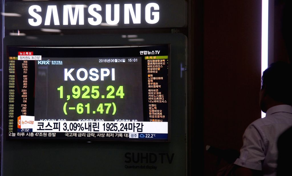SEOUL, June 24, 2016 - A man watches television news report about the stock index in Seoul, South Korea, June 24, 2016. Seoul shares ended sharply lower on Friday as Britain voted to leave the ...