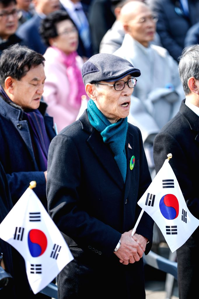 SEOUL, March 1, 2019 - People sing South Korea's national anthem during a ceremony marking the 100th anniversary of the March 1 Independence Movement against Japanese colonial occupation in Seoul, ...