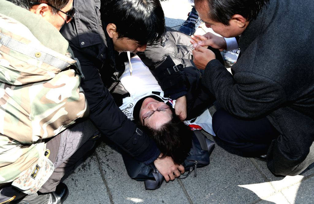 SEOUL, March 10, 2017 - A Park Geun-hye's supporter faints during a rally in Seoul, South Korea, March 10, 2017. Two of South Korean participants in a pro-Park Geun-hye rally held outside the ...