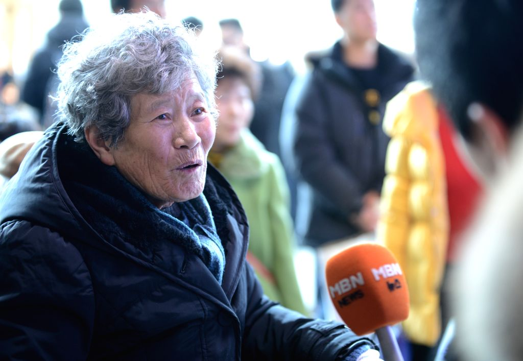SEOUL, March 10, 2017 - A woman is interviewed about Park Geun-hye's impeachment in Seoul, South Korea, March 10, 2017. Impeached President Park Geun-hye of South Korea was permanently removed from ...