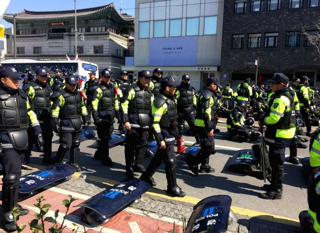 SEOUL, March 10, 2017 - Photo taken by mobile phone shows police gather near the presidential Blue House in Seoul, South Korea, March 10, 2017. South Korean President Park Geun-hye was ousted as the ...