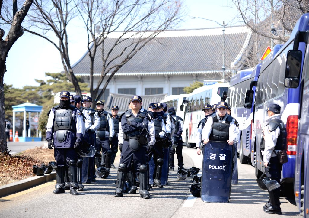 SEOUL, March 10, 2017 - Police gather near the presidential Blue House in Seoul, South Korea, March 10, 2017. South Korean President Park Geun-hye was ousted as the country's head of state on Friday ...