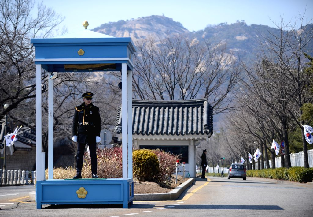SEOUL, March 10, 2017 - Police stand guard outside the presidential Blue House in Seoul, South Korea, March 10, 2017. South Korean President Park Geun-hye was ousted as the country's head of state on ...
