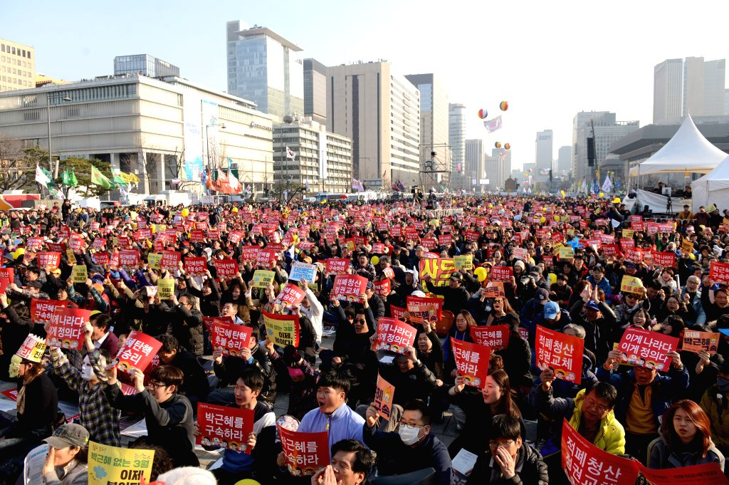 SEOUL, March 11, 2017 - Demonstrators against South Korea's ousted leader Park Geun-hye hold banners during a rally in Seoul, South Korea, March 11, 2017.