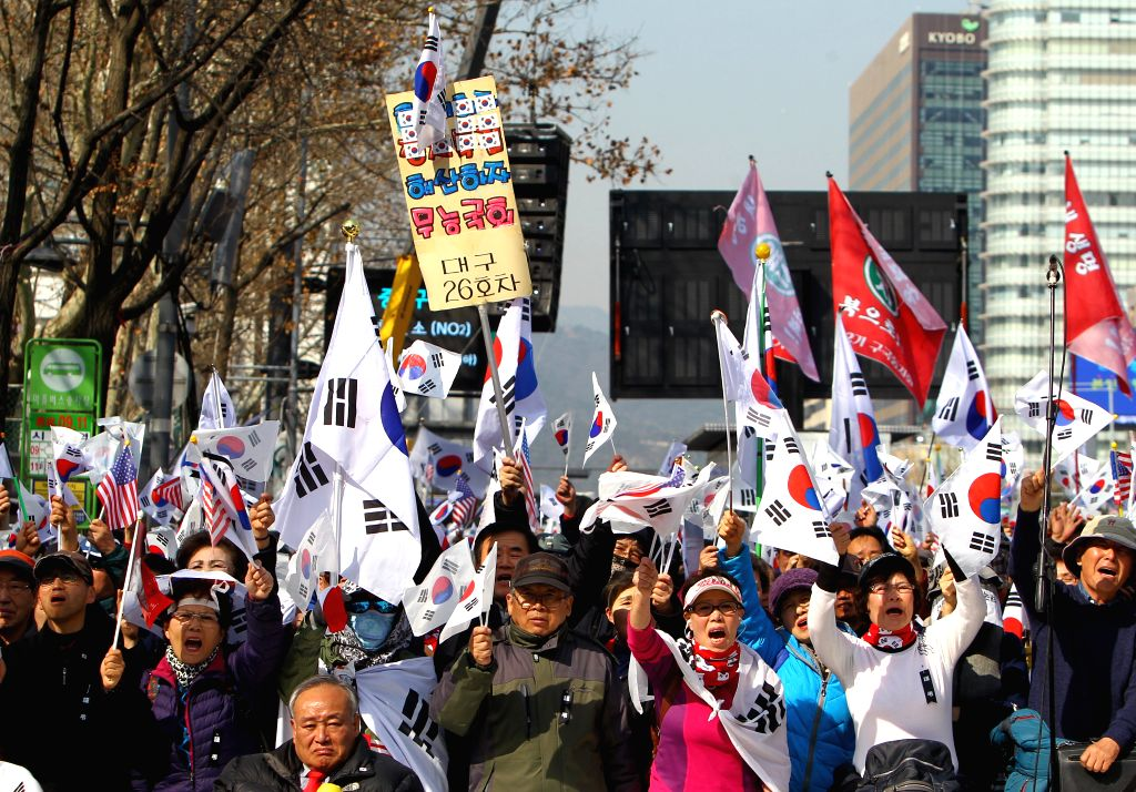 SEOUL, March 11, 2017 - Supporters of South Korea's ousted leader Park Geun-hye shout slogans during a rally in Seoul, South Korea, March 11, 2017.