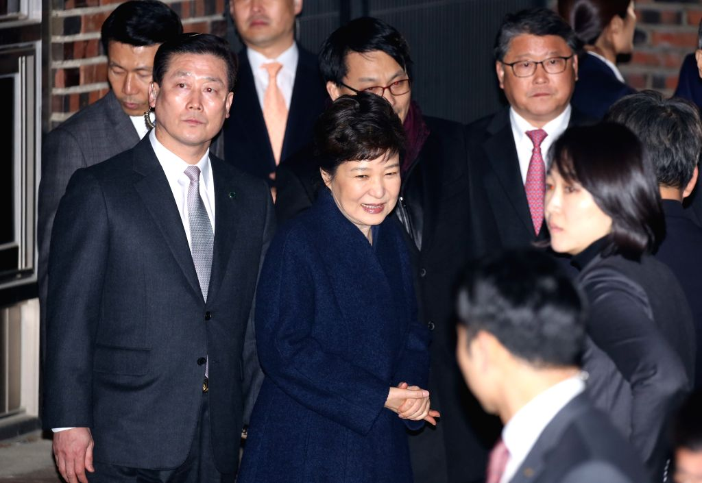 SEOUL, March 12, 2017 - Ousted South Korean President Park Geun-hye (C) arrives at her private residence in Seoul on March 12, 2017. (Xinhua/Lee Sang-ho/IANS)