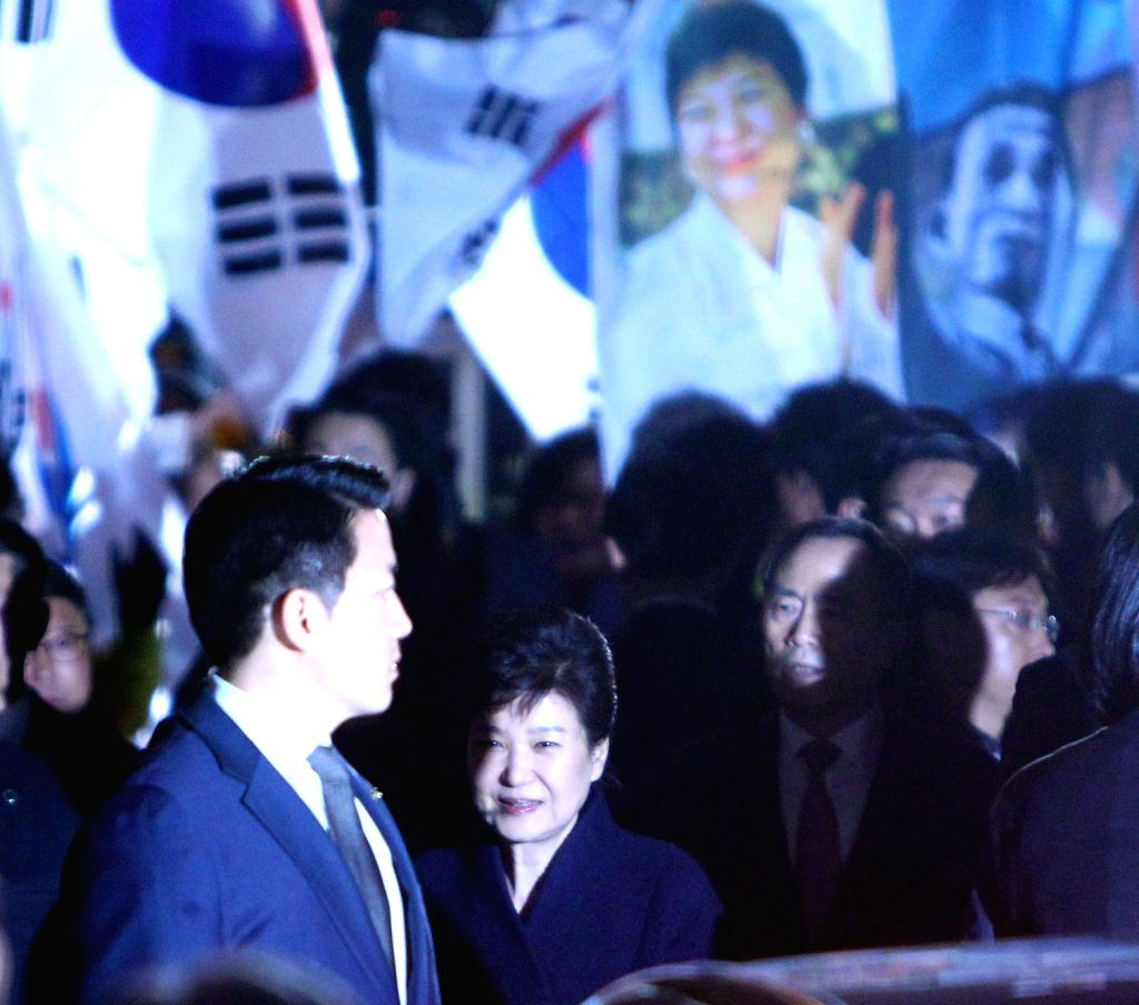 SEOUL, March 12, 2017 - Ousted South Korean President Park Geun-hye (C) arrives at her private residence in Seoul on March 12, 2017.