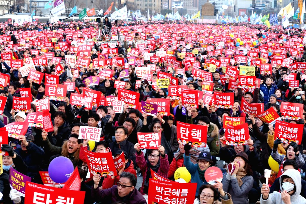 SEOUL, March 4, 2017 - Opponents of President Park Geun-hye hold banners during a rally in Seoul, South Korea, March 4, 2017. Supporters and opponents of South Korean President Park Geun-hye ...