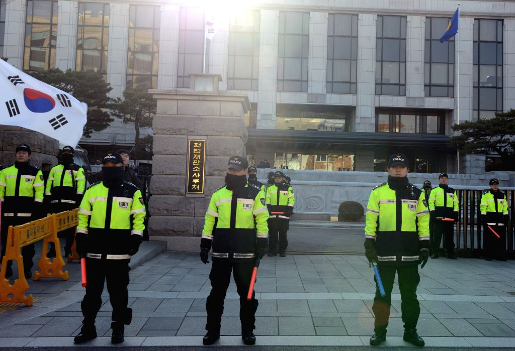 SEOUL, March 9, 2017 - Police officers stand guard in front of the constitutional court in Seoul, South Korea, March 9, 2017. South Korea's constitutional court will make a final ruling on whether to ...