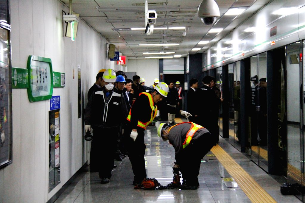 Mechanics work to restore the subway operation at Sangwangsimni Station in Seoul, South Korea, May 2, 2014. Two subway trains collided in Seoul on Friday afternoon, ...