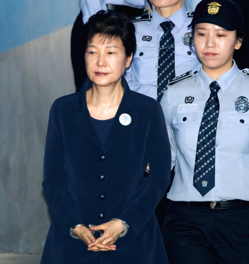 SEOUL, May 23, 2017 - South Korea's former President Park Geun-hye (front) arrives for her first hearing at the Seoul Central District Court in Seoul, South Korea, on May 23, 2017. Ousted South ...
