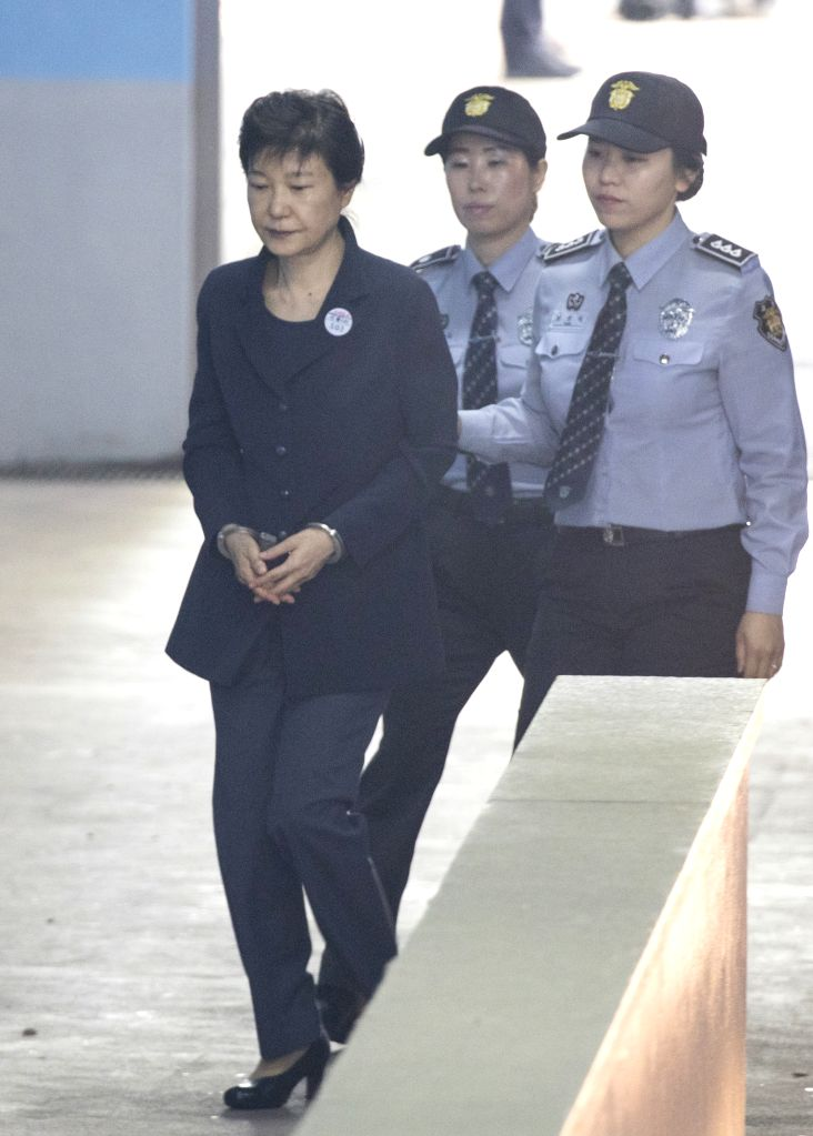 SEOUL, May 25, 2017 - South Korea's former President Park Geun-hye (L) arrives for a trial at the Seoul Central District Court in Seoul, South Korea, on May 25, 2017. (Xinhua/Lee Sang-ho/IANS)