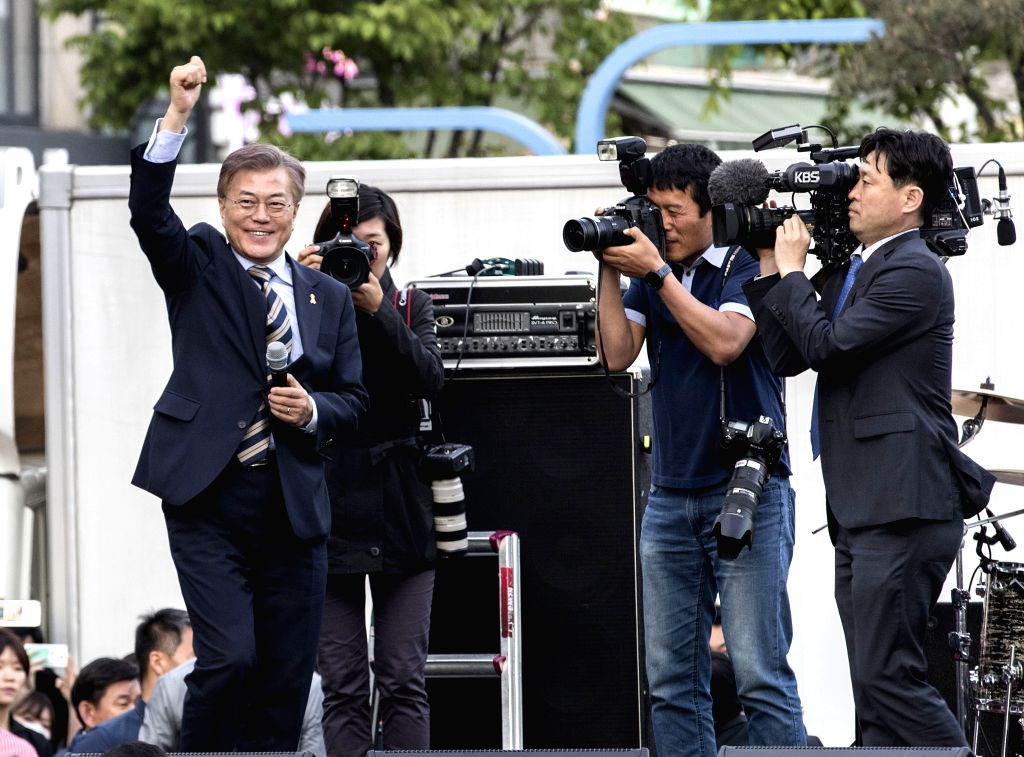 SEOUL, May 6, 2017 - South Korean presidential candidate Moon Jae-in (1st L) of the Democratic Party of Korea attends a campaign in seoul, South Korea, on May 6, 2017. A presidential by-election is ...