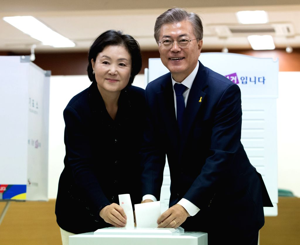 SEOUL, May 9, 2017 - Moon Jae-in (R) of South Korea's Minjoo Party and his wife cast their votes at a polling station in Seoul May 9, 2017. South Korean on Tuesday held the 19th presidential election.