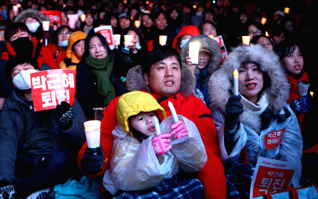 SEOUL, Nov. 26, 2016 - People attend a rally demanding President Park Geun-hye to step down in central Seoul, South Korea, Nov. 26, 2016.