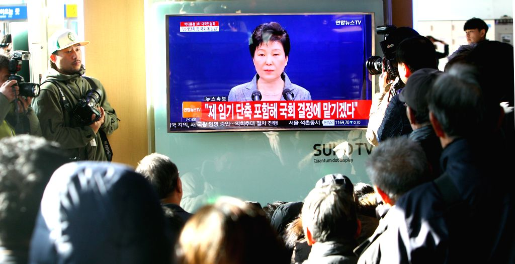 SEOUL, Nov. 29, 2016 - Local residents and media reporters watch South Korean President Park Geun-hye delivering a speech on TV at a railway station in Seoul, capital of South Korea, Nov. 29, 2016. ...