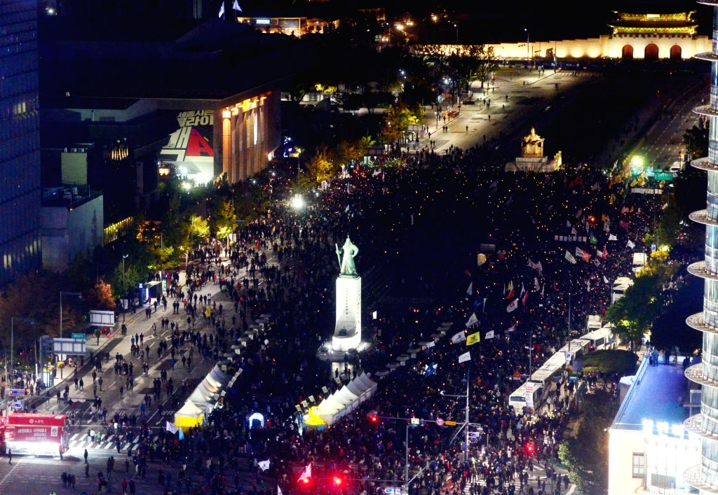 SEOUL, Oct. 30, 2016 - People attend a rally asking for the resignation of South Korean President Park Geun-hye in Seoul, South Korea, Oct. 29, 2016. Over the past week pressure has been mounting on ...