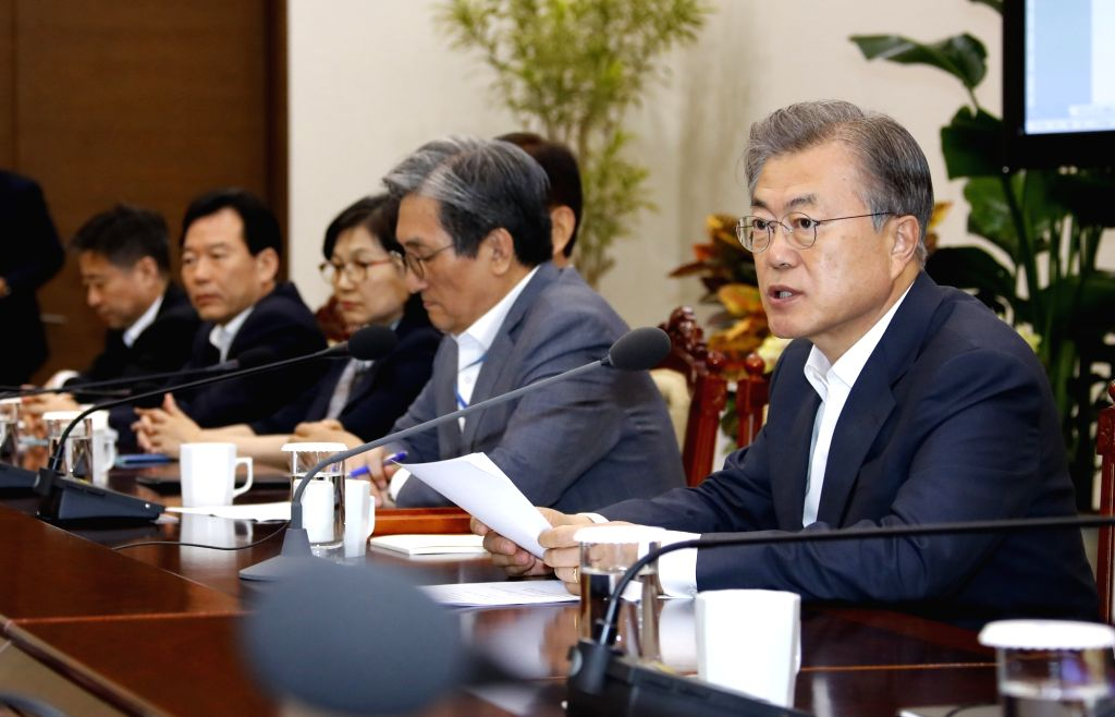Seoul: President Moon Jae-in (R) presides over a meeting of his senior secretaries at the presidential office in Seoul on May 20, 2019.(Yonhap/IANS)