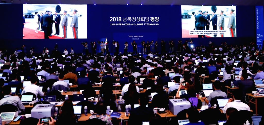 SEOUL, Sept. 18, 2018 - Journalists watch a live broadcast of the arrival of South Korean President Moon Jae-in at Pyongyang International Airport, at the press center for the 2018 Inter-Korean ...