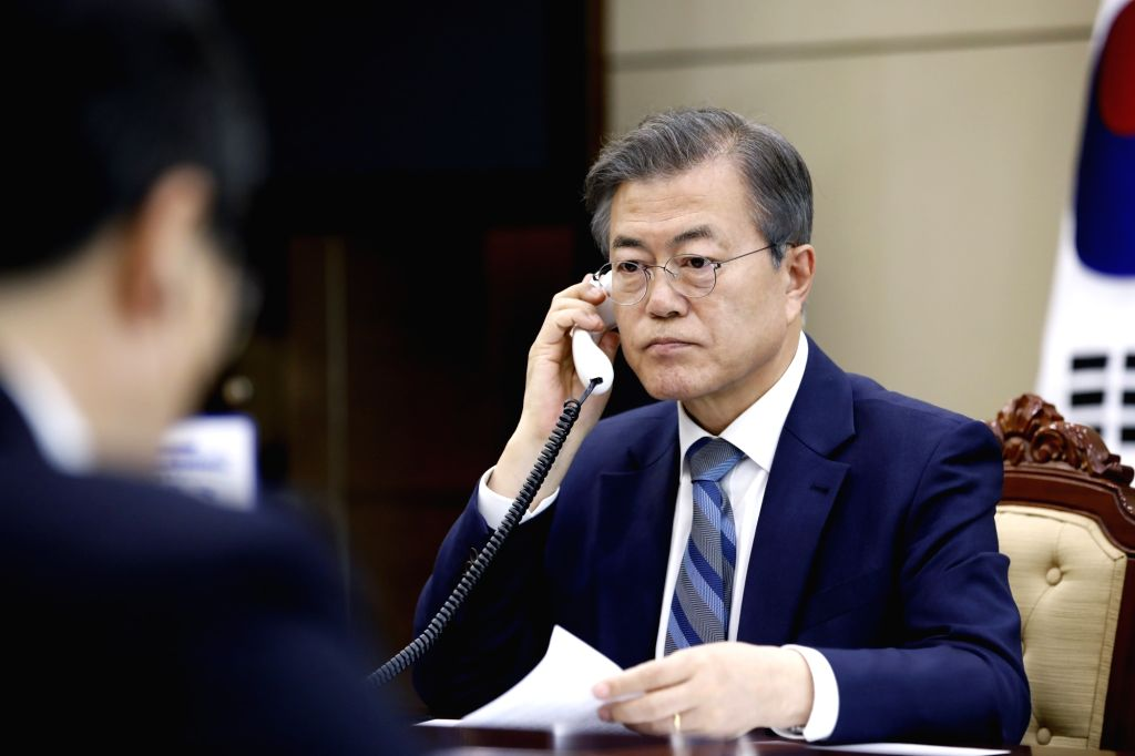 Seoul: South Korean President Moon Jae-in has a telephone conversation with Japanese Prime Minister Shinzo Abe at his office in Seoul on April 24, 2018, in this photo provided by the office. Abe expressed his hope to meet with North Korean leader Kim - Shinzo Abe