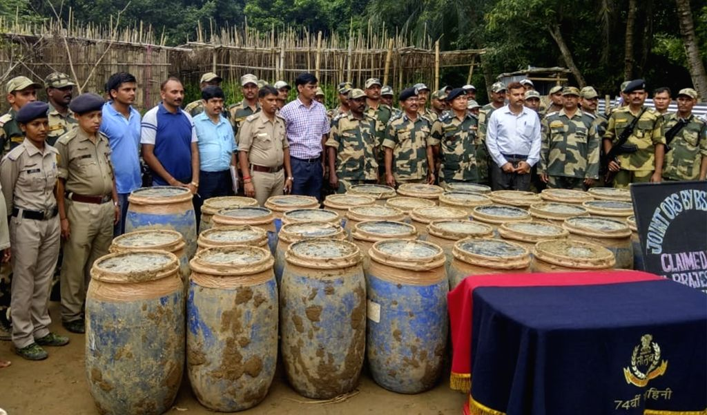 :Sepahijala: Security personnel present before press 3,350 kg of dry cannabis (ganja) valued over Rs 2 crore and the two persons arrested by them in Sepahijala district in west Tripura on Aug 3, ...