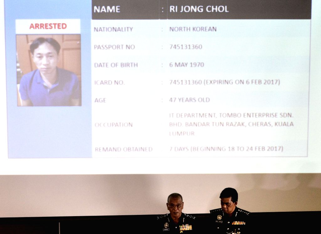 SEPANG, March 2, 2017 - File photo taken on Feb. 19, 2017 shows Malaysia's Deputy Inspector-General of Police Noor Rashid Ibrahim (L) releasing the information of a DPRK suspect at a press conference ...