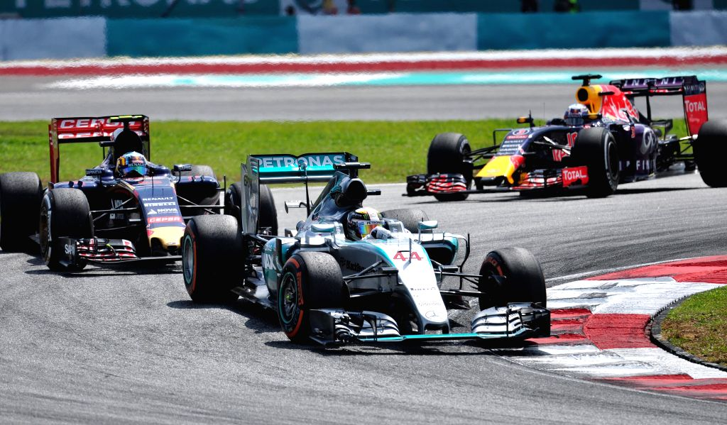 Mercedes driver Lewis Hamilton (front) of Britain competes during the Malaysian Formula One Grand Prix in Sepang, Malaysia, March 29, 2015. (Xinhua/Chong Voon ...