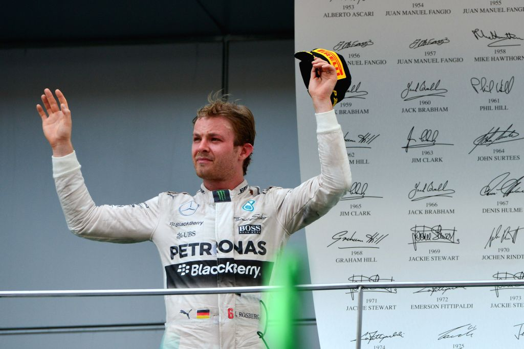 Mercedes driver Nico Rosberg (R) of Germany waves after the Malaysian Formula One Grand Prix in Sepang, Malaysia, March 29, 2015.