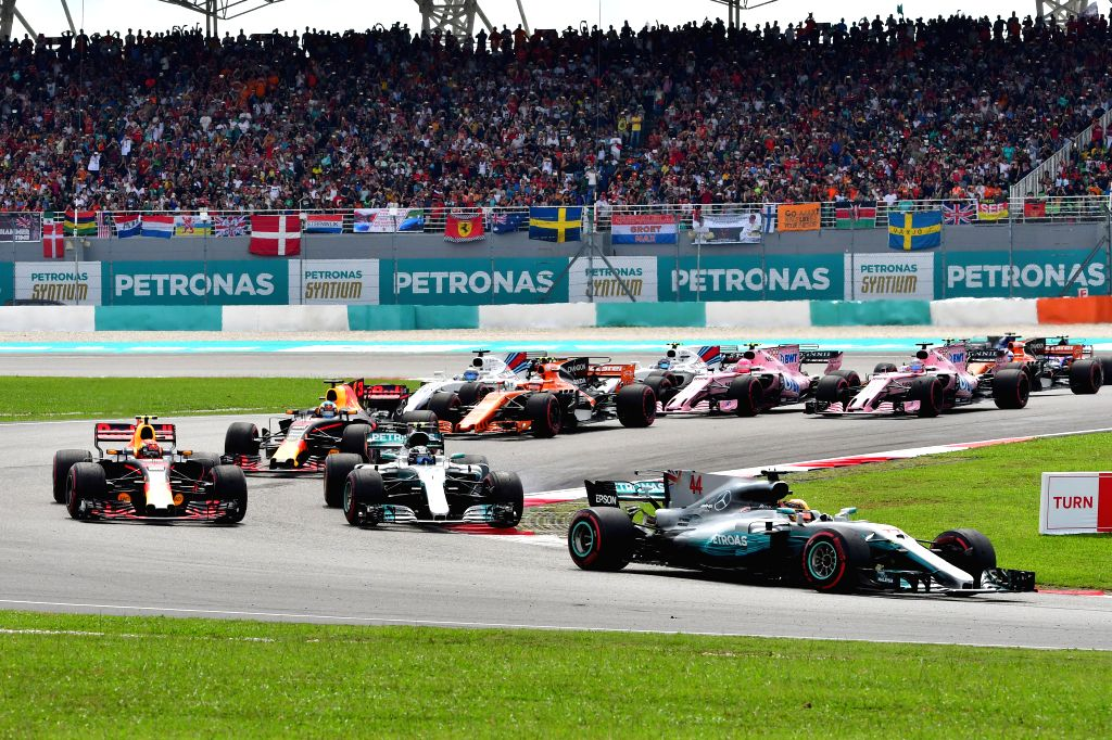 SEPANG, Oct. 1, 2017 - Mercedes driver Lewis Hamilton (front) of Britain drives at the Formula One Malaysia Grand Prix at the Sepang Circuit in Malaysia, on Oct. 1, 2017. Max Verstappen claimed the ...