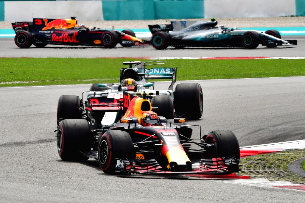 SEPANG, Oct. 1, 2017 - Red Bull driver Max Verstappen (front) of the Netherlands and Mercedes driver Lewis Hamilton of Britain compete during the Formula One Malaysia Grand Prix at the Sepang Circuit ...