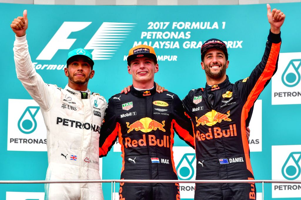 SEPANG, Oct. 1, 2017 - Red Bull driver Max Verstappen (C) of the Netherlands, Mercedes driver Lewis Hamilton (L) of Britain and Red Bull driver Daniel Ricciardo of Australia pose for pictures on the ...
