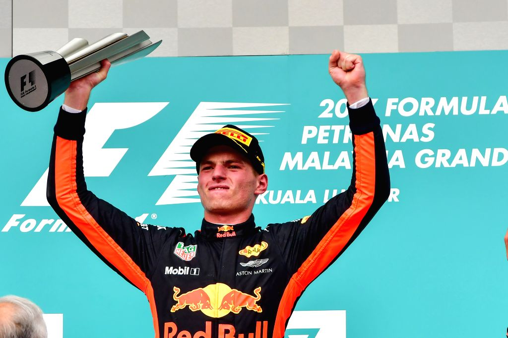 SEPANG, Oct. 1, 2017 - Red Bull driver Max Verstappen of the Netherlands celebrates on the podium after the Formula One Malaysia Grand Prix at the Sepang Circuit in Malaysia, on Oct. 1, 2017. Max ...