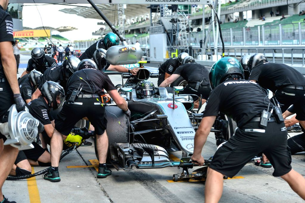 SEPANG, Sept. 30, 2016 - Mechanics for Mercedes driver Nico Rosberg of Germany work on his car during the second practice session of the Malaysian Formula One Grand Prix at the Sepang International ...