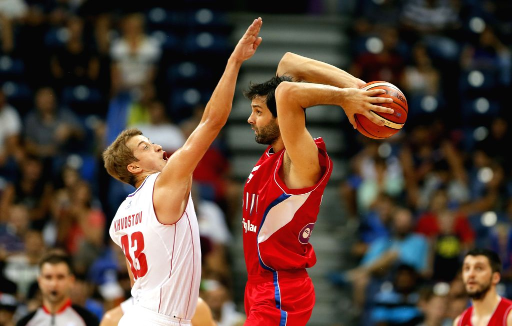 """Serbia's Milos Teodosic (R) vies with Russia's Dmitry Khvostov (L) during """"Belgrade Cup"""" final basketball match between Serbia and Russia at the Kombank ..."""