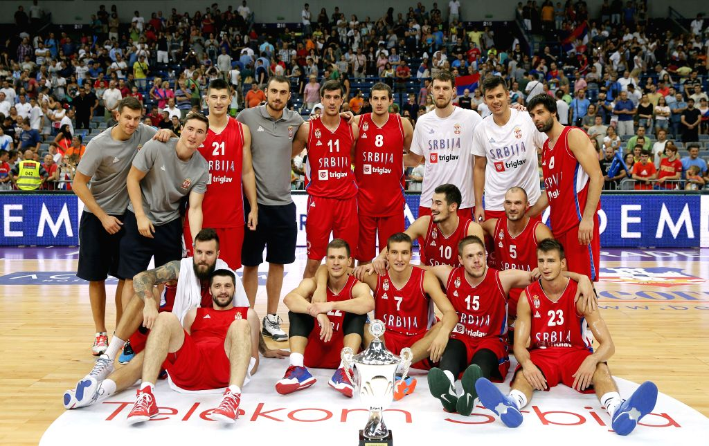 """Serbia's national basketball team players pose for the photo with trophy for the first place during """"Belgrade Cup"""" final basketball match between Serbia ..."""