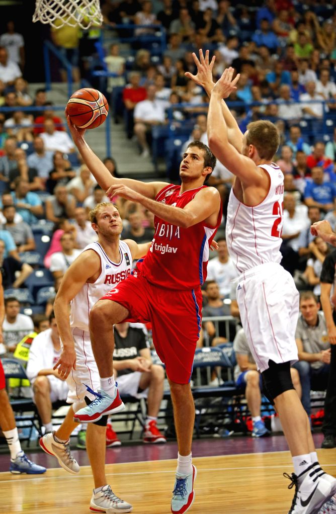 """Serbia's Nemanja Bjelica (L) vies with Russia's Andrey Vorontsevich (R) during """"Belgrade Cup"""" final basketball match between Serbia and Russia at the ..."""