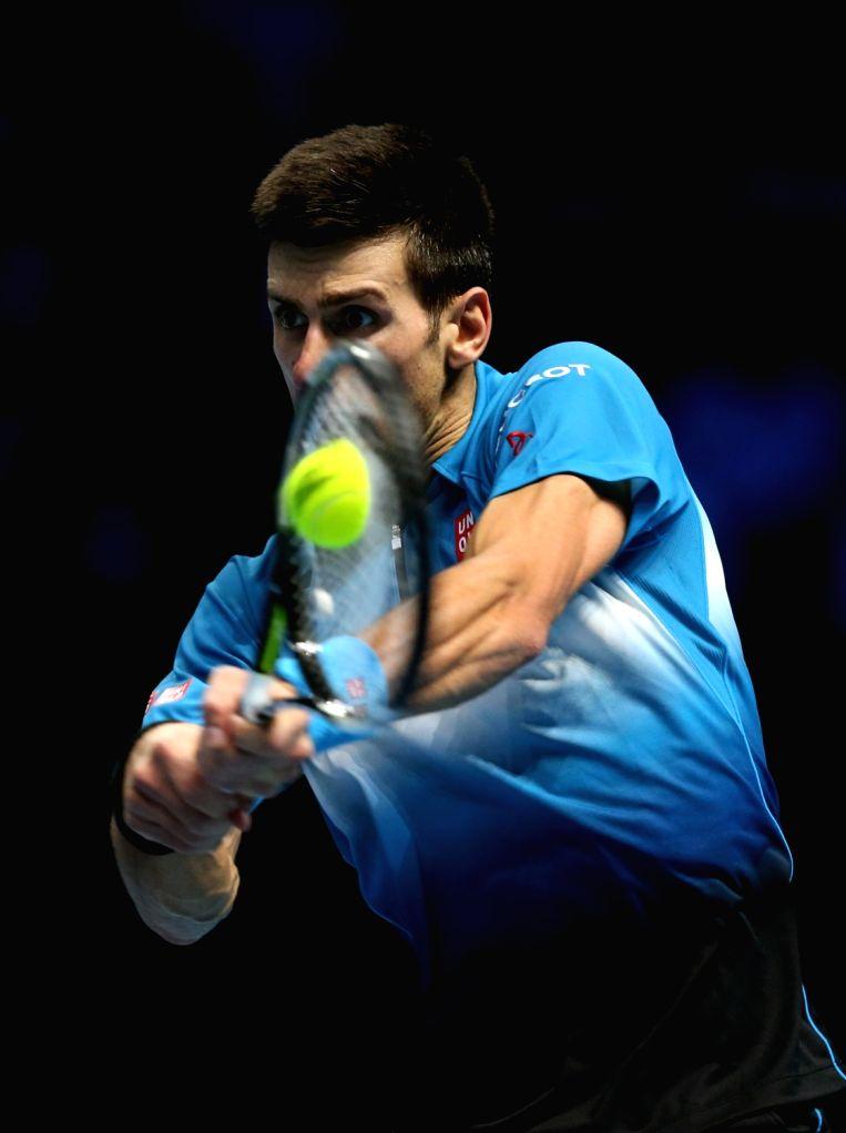 Serbia's Novak Djokovic plays a shot against Czech Republic's Tomas Berdych during a men's singles match the ATP World Tour Finals tennis tournament in London on ...