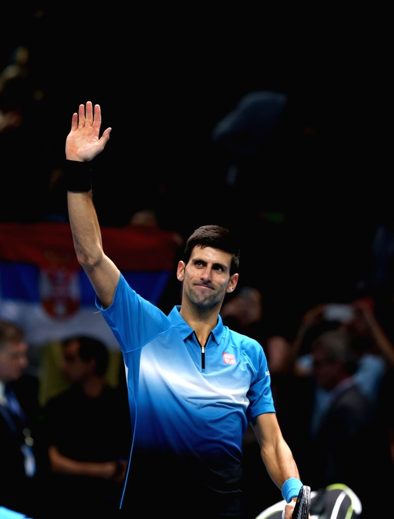 Serbia's Novak Djokovic waves to the crowd after a men's singles match against Czech Republic's Tomas Berdych the ATP World Tour Finals tennis tournament in London ...