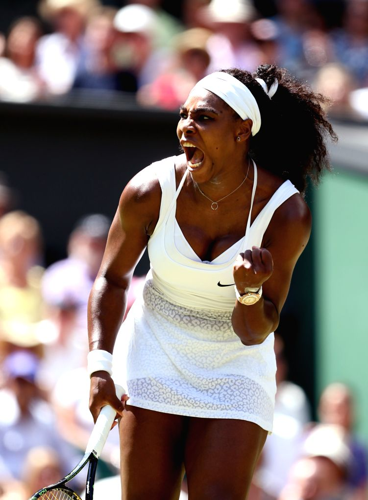 Serena Williams of the United States celebrates scoring during the women's singles final with Garbine Muguruza of Spain at the 2015 Wimbledon Championships in ...