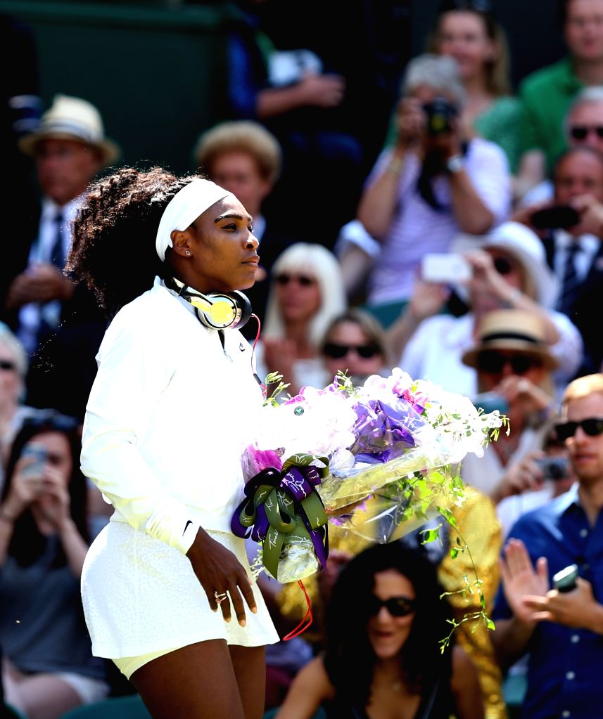 Serena Williams of the United States reacts before the women's singles final with Garbine Muguruza of Spain at the 2015 Wimbledon Championships in Wimbledon, ...