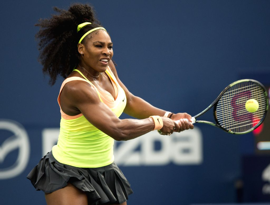 Serena Williams of the United States returns the ball against Andrea Petkovic of Germany during their third round women's singles match at the 2015 Rogers Cup in ...