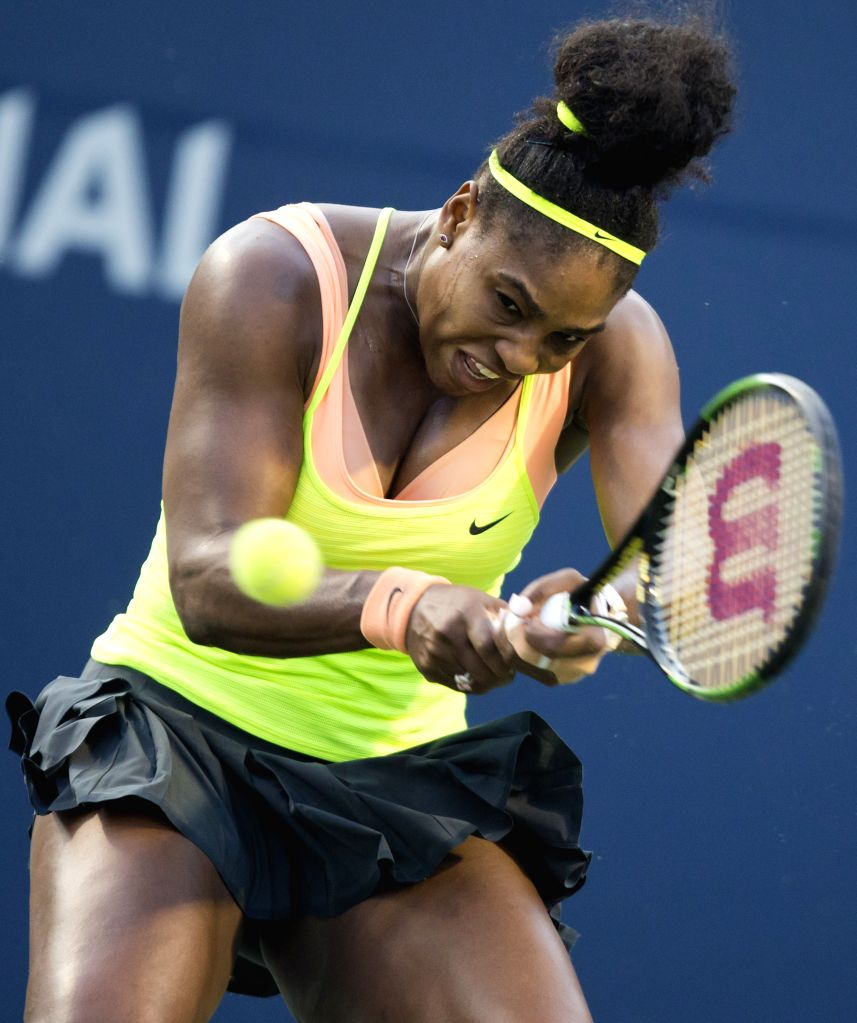 Serena Williams of the United States returns the ball against Belinda Bencic of Switerland during their semifinal match of women's singles at the 2015 Rogers Cup in ...