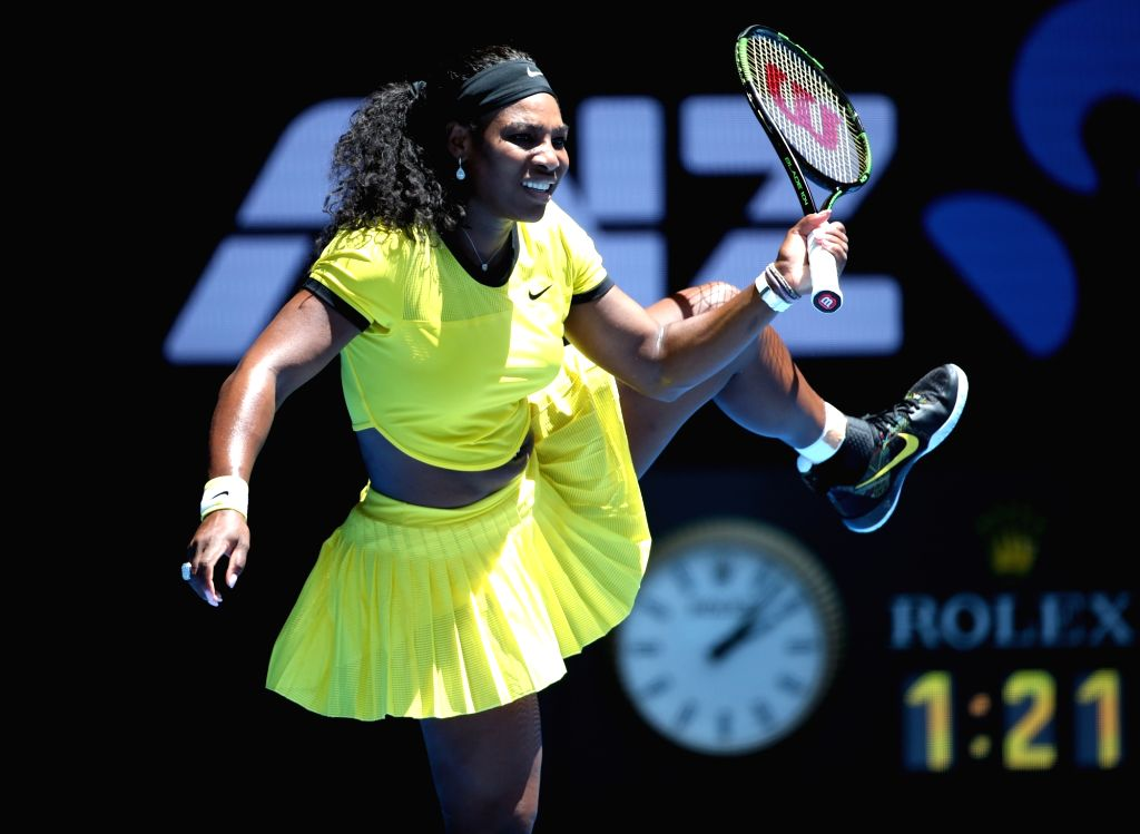 Serena Williams of the United States returns the ball during the women's singles first-round match against Camila Giorgi of Italy at the Australian Open Tennis ...