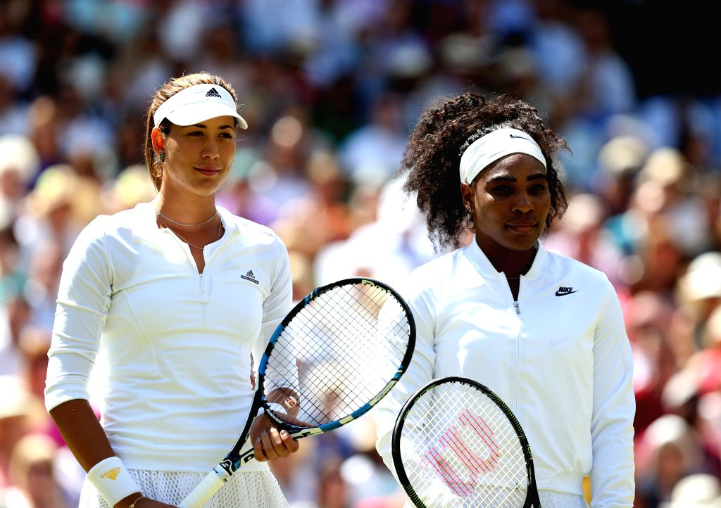Serena Williams (R) of the United States poses with Garbine Muguruza of Spain ahead of the women's singles final at the 2015 Wimbledon Championships in Wimbledon, ...