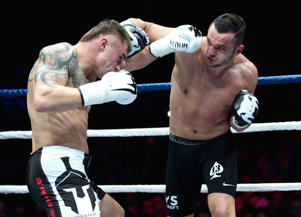 Sergej Maslobojev (L) from Lithuania fights with Robert Dorin from Romania in a KOK world belt 93kg title match in Vilnius, Lithuania, Nov. 14, 2015. Maslobojev won ...