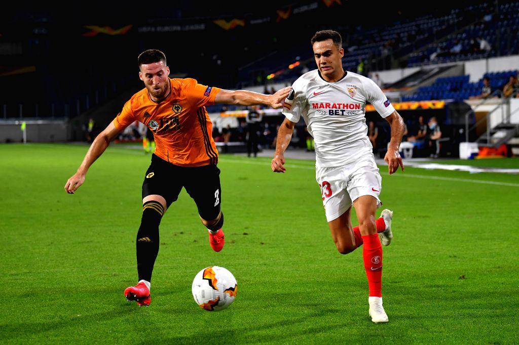 Sergio Reguilon (R) of Sevilla vies with Matt Doherty of Wolverhampton Wanderers during the UEFA Europa League quarterfinal between Wolverhampton Wanderers and ...