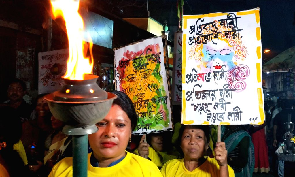 Sex workers participate in a rally to press for their demands in Kolkata on March 3, 2019.